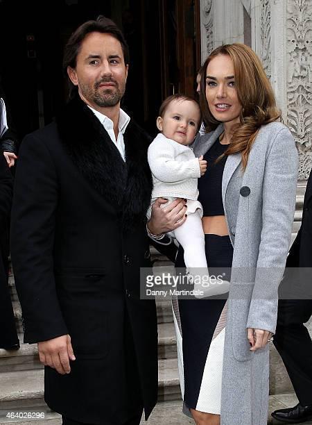 Tamara Ecclestone Jay Rutland and baby Sophia Ecclestone arrive for the Julien MacDonald show on February 21 2015 in London England