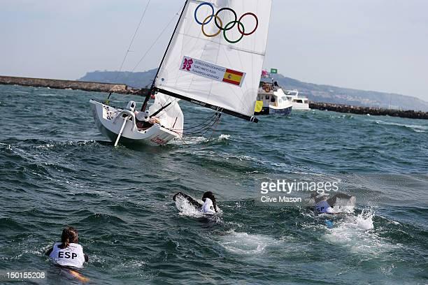 Tamara Echegoyen Dominguez Sofia Toro Prieto Puga and Angela Pumariega Menendez of Spain jump into the sea as they celebrate finishing first to win...