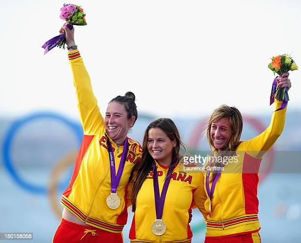Tamara Echegoyen Dominguez Sofia Toro Prieto Puga and Angela Pumariega Menendez of Spain celebrate winning gold in the Women's Elliott 6m WMR Sailing...