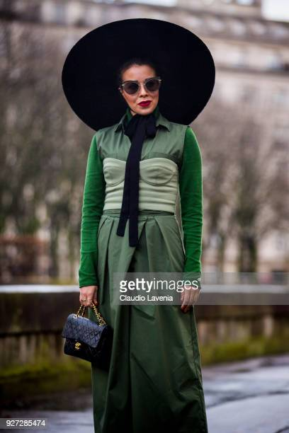 Tamara Gonzalez Perea wearing green dress and Chanel black bag is seen in the streets of Paris before the Valentino show during Paris Fashion Week...
