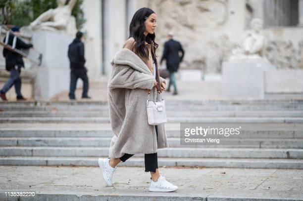 Tamara Kalinic is seen wearing grey teddy coat cropped denim jeans bag cropped beige jacket sneakers outside Tods lunch during Paris Fashion Week...