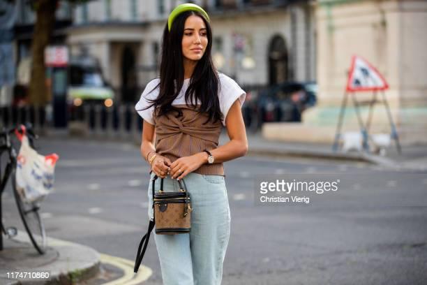 Tamara Kalinic is seen wearing hair loop, denim jeans, Louis Vuitton bag outside Toga during London Fashion Week September 2019 on September 14, 2019...