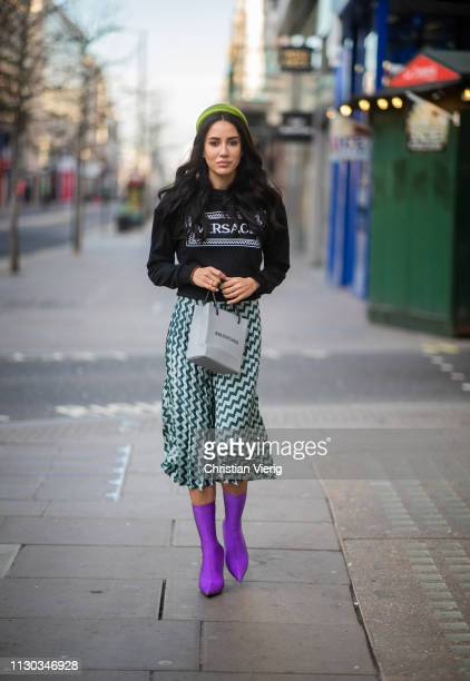 Tamara Kalinic is seen wearing skirt with print, Balenciaga bag, Versace sweater, hair loop outside Natasha Zinko during London Fashion Week February...