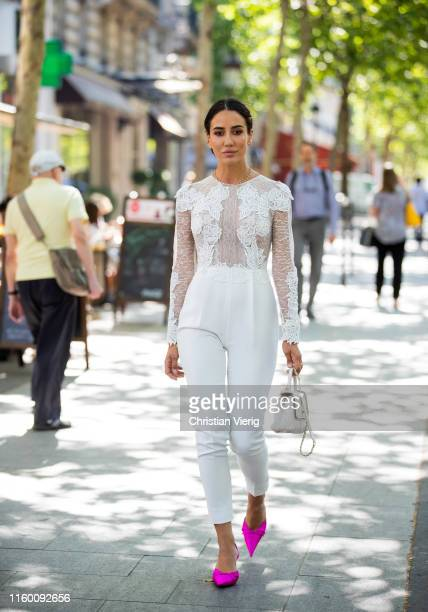 Tamara Kalinic is seen wearing white laced top, white pants, Chanel bag, pink heels outside Zuhair Murad during Paris Fashion Week - Haute Couture...