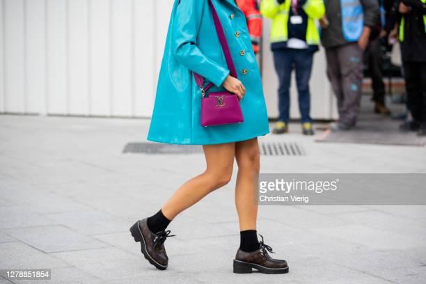Tamara Kalinic seen wearing turquoise bag, purple bag outside Louis Vuitton during Paris Fashion Week - Womenswear Spring Summer 2021 : Day Nine on...
