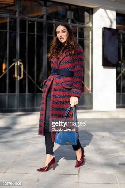 Tamara Kalinic wearing a long striped blue and burgundy coat black jeans burgundy heels and blue Chanel bag is seen outside Ulyana Sergeenko during...