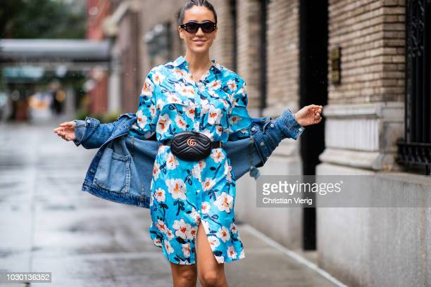 Tamara Kalinic wearing blue dress with floral print denim jacket Gucci fanny bag Louis Vuitton sneakers is seen outside Escada during New York...