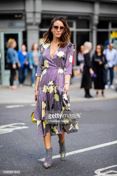 Tamara Kalinic wearing dress yellow bag ankle boots is seen outside Molly Goddard during London Fashion Week September 2018 on September 15 2018 in...