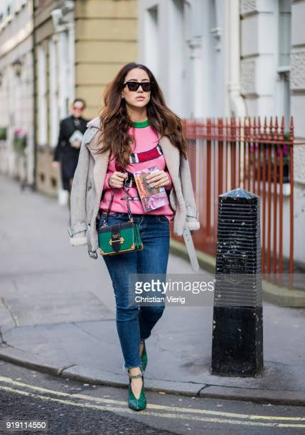 Tamara Kalinic wearing navy denim jeans Prada bag pink Gucci sweater jacket seen outside Mulberry during London Fashion Week February 2018 on...