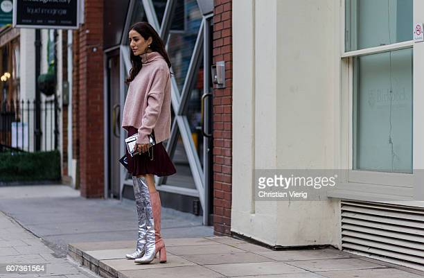 Tamara Kalinic wearing silver overknees pink sweater purple mini skirt outside of JW Anderson during London Fashion Week Spring/Summer collections...