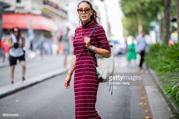 Tamara Kalinic wearing striped dress, Chanel backpack is seen outside Viktor & Rolf on day four during Paris Fashion Week Haute Couture FW18 on July...