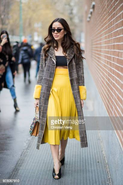 Tamara Kalinic wearing yellow skirt plaid coat Fendi bag seen outside Fendi during Milan Fashion Week Fall/Winter 2018/19 on February 22 2018 in...
