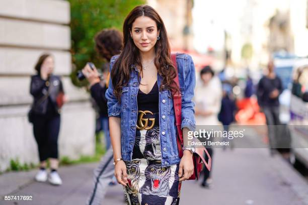 Tamara Kalinic wears a blue denim jacket a Dior bag a Gucci belt a print skirt outside Moncler during Paris Fashion Week Womenswear Spring/Summer...