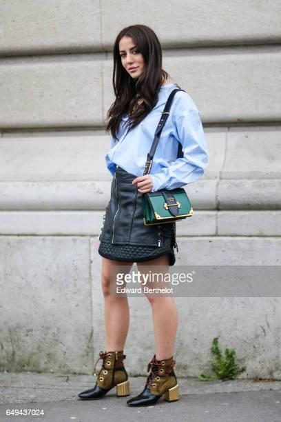 Tamara Kalinic wears a blue shirt a Prada bag outside the Moncler Gamme Rouge show during Paris Fashion Week Womenswear Fall/Winter 2017/2018 on...