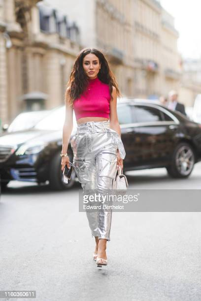 Tamara Kalinic wears a pink turtleneck cropped top silver cropped pants a white bag shoes outside Ralph Russo during Paris Fashion Week Haute Couture...