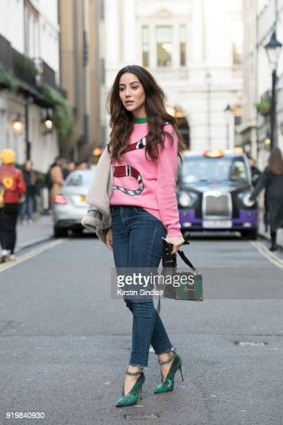Tamara Kalinic wears a Prada bag Jimmy Choo shoes Gucci sweater Levi's jeans on day one of London Womens Fashion Week Autumn/Winter 2018 on February...