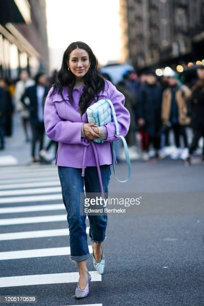 Tamara Kalinic wears a purple jacket a blue Bottega Veneta quilted bag blue jeans with ripped hem glitter pointy shoes earrings outside Zadig...