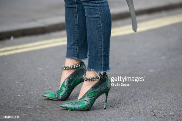 Tamara Kalinic wears Jimmy Choo shoes and Levi's jeans on day one of London Womens Fashion Week Autumn/Winter 2018 on February 16 2018 in London...