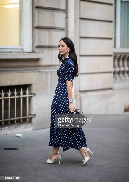Tamara Kallinic is seen wearing dress with dots print during Paris Fashion Week Womenswear Fall/Winter 2019/2020 on March 01, 2019 in Paris, France.