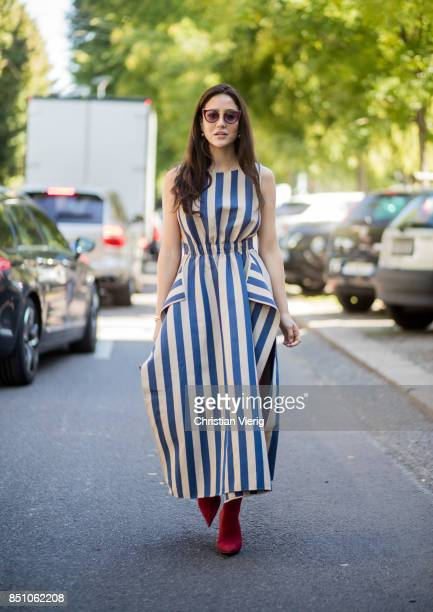 Tamara Kilic wearing striped dress Fendi bag is seen outside Fendi during Milan Fashion Week Spring/Summer 2018 on September 21 2017 in Milan Italy