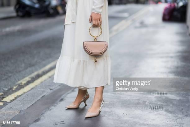 Tamara Kilic wearing white dress Chloe bag outside Peter Pilotto during London Fashion Week September 2017 on September 17 2017 in London England