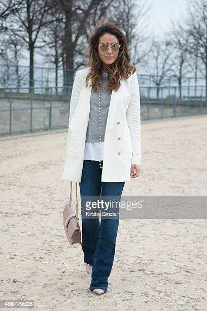 Tamara Killinic wears Superfresh jacket Valentino shoes and bag 360Sweater top River Island shirt and jeans Chanel necklace and Dior sunglasses on...