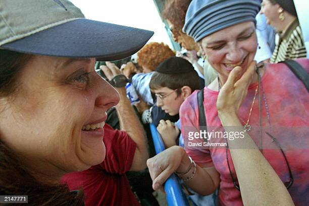 Tamara Laufer cries as she is welcomed by hometown friend Michelle Bieber to Israel's Ben Gurion Airport July 9 2003 in Tel Aviv Israel Approximately...
