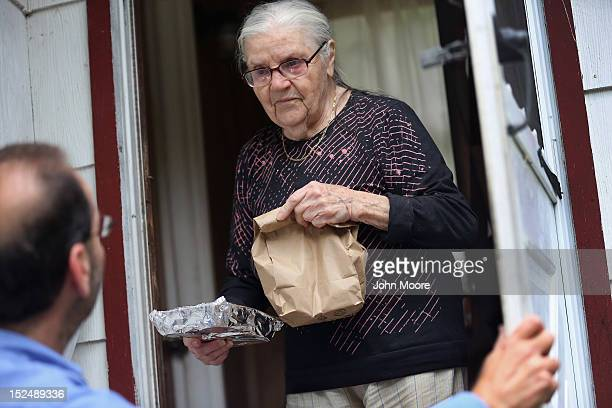 Tamara Lycholaj receives a hot meal from nutrition worker Al Patalona from the Sullivan County Office for the Aging as he makes Meals on Wheels...