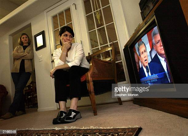 Tamara Nicolle watches US President George W Bush's State of the Union address while her friend Christen Stasevich stands behind her in Tamara's...