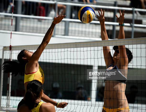 Tamara Otene of New Zealand jmps for the ball against Pawarun Chanthawichai of Thailand in the Women's Round of 24 during day 7 of Buenos Aires Youth...