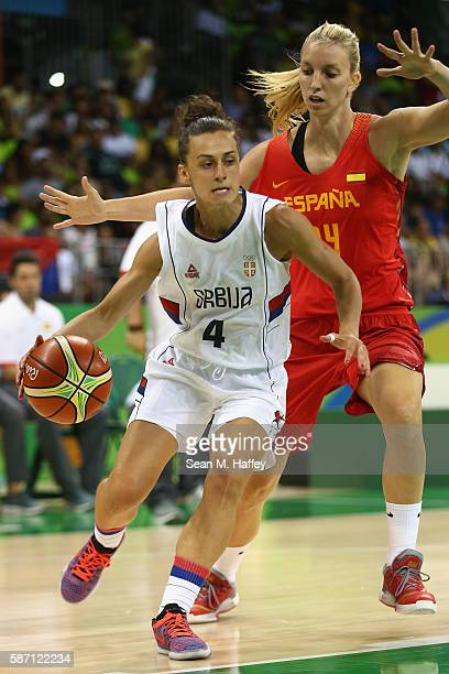Tamara Radocaj of Serbia dribbles past Laura Gil of Spain during a Women's Basketball preliminary round game on Day 2 of the Rio 2016 Olympic Games...