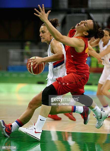 Tamara Radocaj of Serbia dribbles past Silvia Dominguez of Spain during a Women's Basketball preliminary round game on Day 2 of the Rio 2016 Olympic...