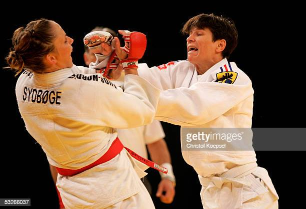 Tamara Strnad of Slovenia in action against Isabelle Bacon of France in the discipline JuJitsu in the class of till 62 kilogram during the World...