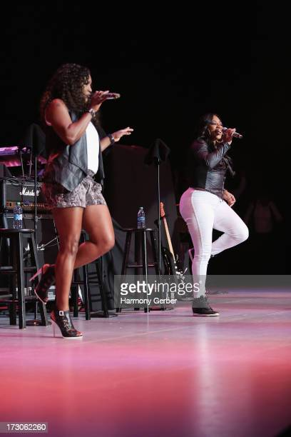 Tamara 'Taj' JohnsonGeorge and Lelee Lyons of SWV perform at the Greek Theatre on July 5 2013 in Los Angeles California
