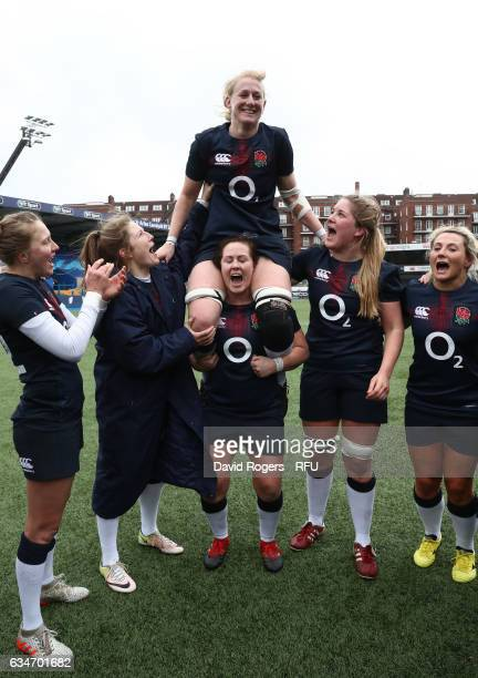 Tamara Taylor of England is carried aloft by teammates after making her 100th appearance during the Womens Six Nations match between Wales and...