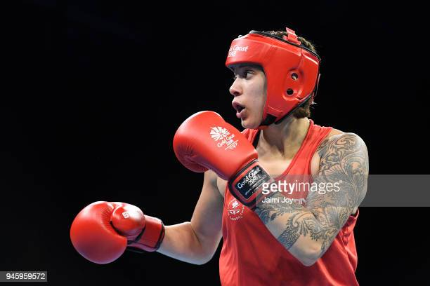 Tamara Thibeault of Canada fights against Lauren Price of Wales the Women's Middle 6975kg Semifinal bout during Boxing on day nine of the Gold Coast...