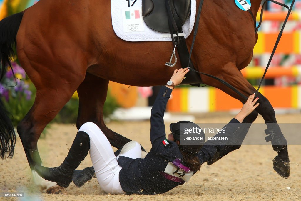 Tamara Vega of Mexico riding Douce de Roulad from her mount during the Riding Show Jumping in the Women's Modern Pentathlon on Day 16 of the London 2012 Olympic Games on August 12, 2012 in London, England.