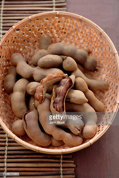 Tamarind pods in wicker basket