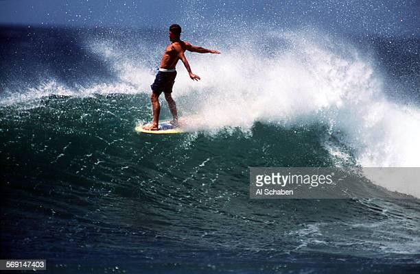 LStamarindowingnut0417AS––PLAYA NEGRA COSTA RICA––Surfing movie star Robert 'Wingnut' Weaver rides a Playa Negra wave on the nose of his longboard...