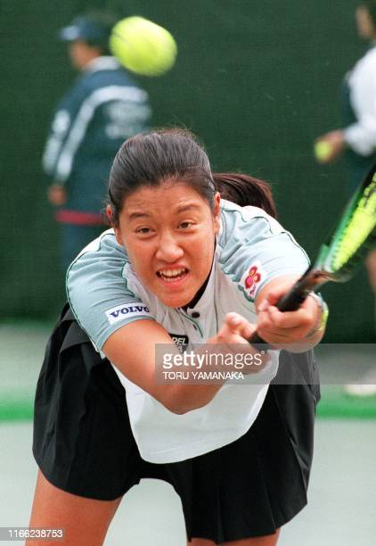 Tamarine Tanasugarn of Thailand stretches for the ball during her secondround match against Lori McNeil of USA in the Japan Open tennis tournament in...