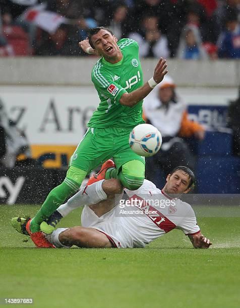 Tamas Hajnal of Stuttgart fights for the ball with Mario Mandzukic of Wolfsburg during the Bundesliga match between VfB Stuttgart and VfL Wolfsburg...
