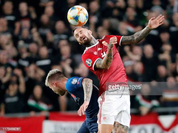 Tamas Kadar of Hungary battles for the ball in the air with Albert Rusnak of Slovakia during the 2020 UEFA European Championships group E qualifying...
