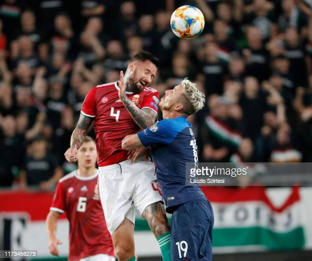 Tamas Kadar of Hungary battles for the ball in the air with Juraj Kucka of Slovakia during the 2020 UEFA European Championships group E qualifying...