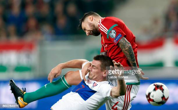 Tamas Kadar of Hungary tangles with Frodi Benjaminsen of Faroe Islands during the FIFA 2018 World Cup Qualifier match between Hungary and Faroe...