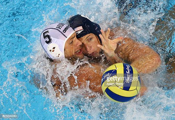 Tamas Kasas of Hungary battles with Tony Azevedo of the United States during the Men's Gold Medal Water Polo Match at the Yingdong Natatorium of...