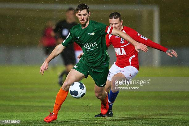 Tamas MaffeyStumpe of the Heat competes with Mirjian Pavlovic of United during the FFA Cup match between Sydney United 58 FC and the FNQ Heat at...