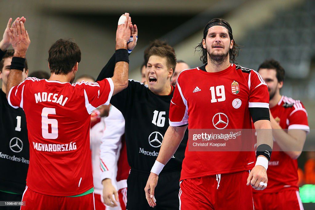 Tamas Mocsai, Roland Miker and Laszlo Nagy of Hungary celebrate after the round of sixteen match between Hungary and Poland at Palau Sant Jordi on January 21, 2013 in Barcelona, Spain. The match between Hungary and Poland ended 27-19.