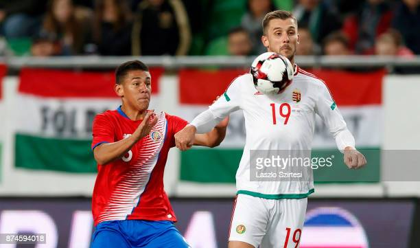 Tamas Priskin of Hungary wins the ball from Oscar Duarte of Costa Rica during the at Groupama Arena on November 14 2017 in Budapest Hungary
