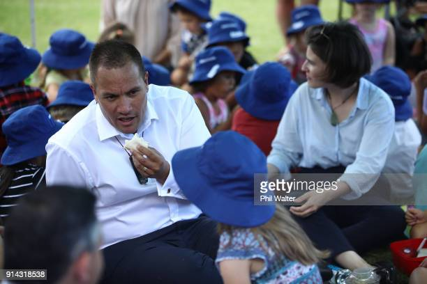 Tamati Coffey of the Labour Party and Green Party MP Chloe Swarbrick share a picnic with children from Paihia Primary School on February 5 2018 in...