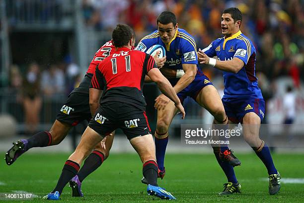 Tamati Ellison of the Highlanders is tackled during the round two Super Rugby match between the Highlanders and the Crusaders at Forsyth Barr Stadium...